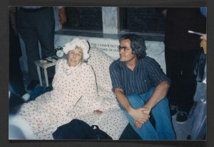 Jane Wood sleeps in the lobby of her building (2003).